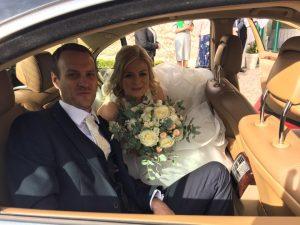 Newly weds getting into Sligo Chauffeur's Mercedes Benz
