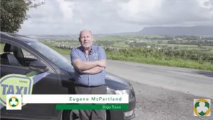 Eugene McPartland in front of his taxi with Benbulben in background
